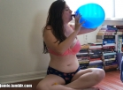 Jamie blows up two balloons