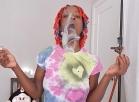[Image: tye dye smoking with halloween town pipe]