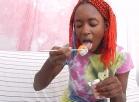 [Image: eating sushi tyedye top]