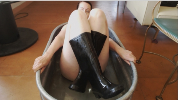 Naked girl wearing rubber boots authoritative
